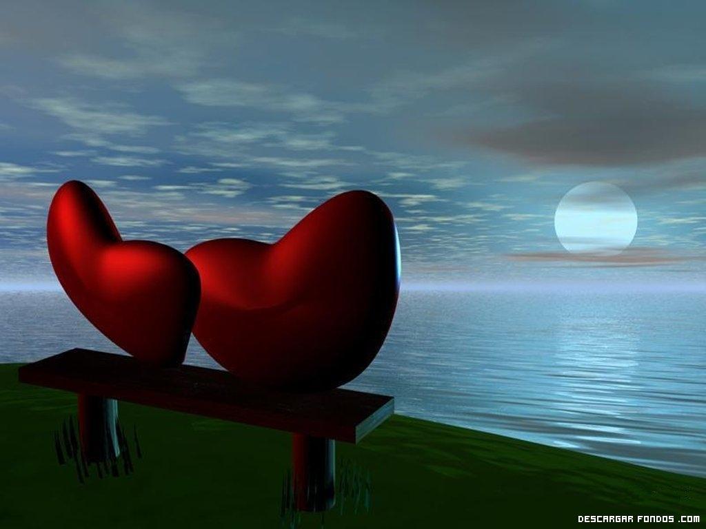 Una pareja de corazones frente al mar
